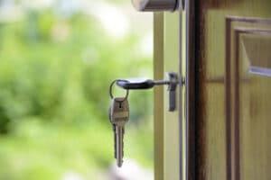 Keys and lock the door on the background of solar garden